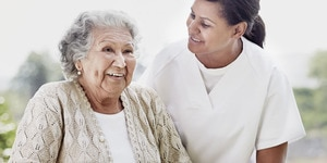 Nurse and senior woman enjoy eachother's company