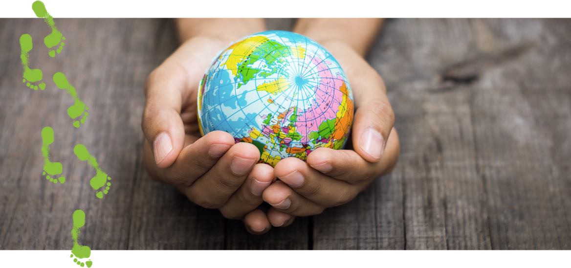 A small colorful globe is cradled in cupped hands.