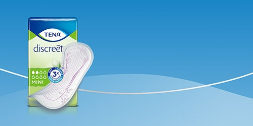 Packshot of TENA Discreet mini on blue background
