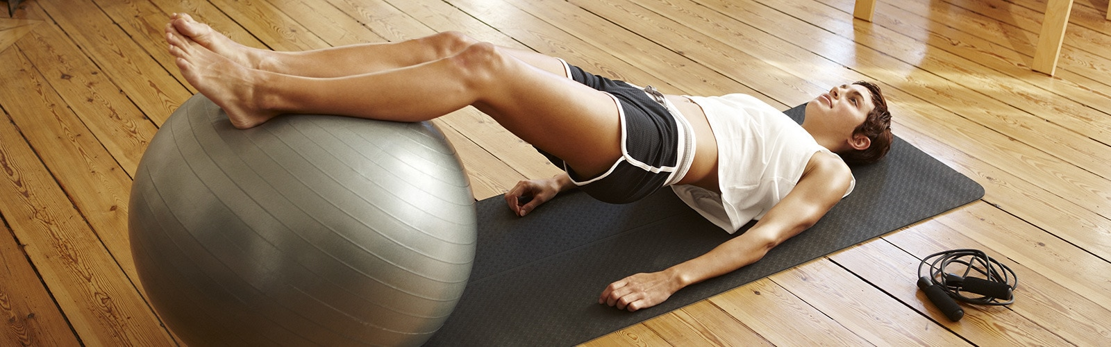 Woman doing pilates workout with ball
