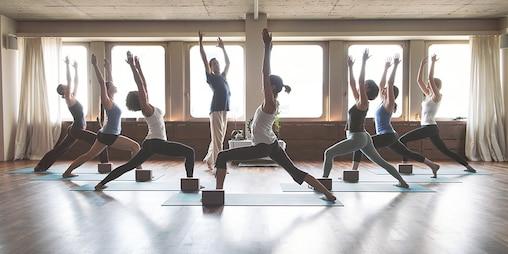 Eight people in yoga class.