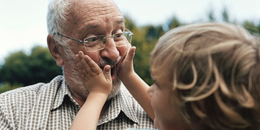 Grandfather making faces with grandson