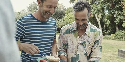 Men eating in garden