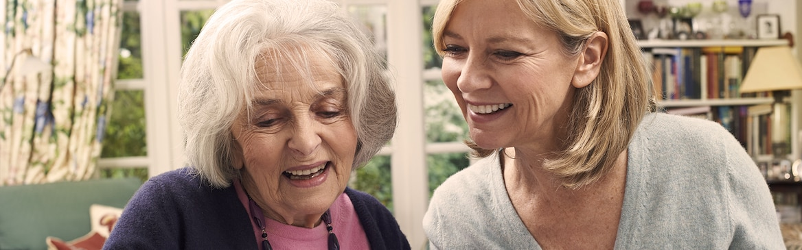 Younger woman and older woman laughing