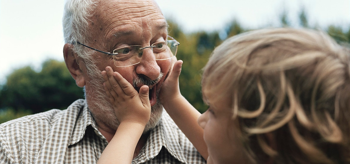 Grandfather making faces with grandchild