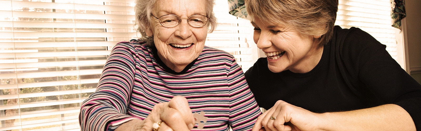 Young woman and older woman doing a puzzle