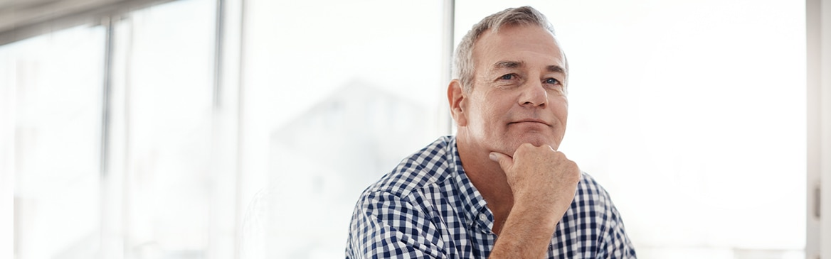 Man resting head on hand smiling