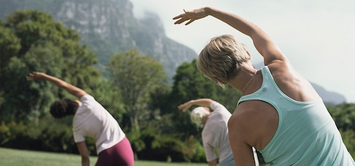 TENA Women lifestyle, Group of women exercising in the park