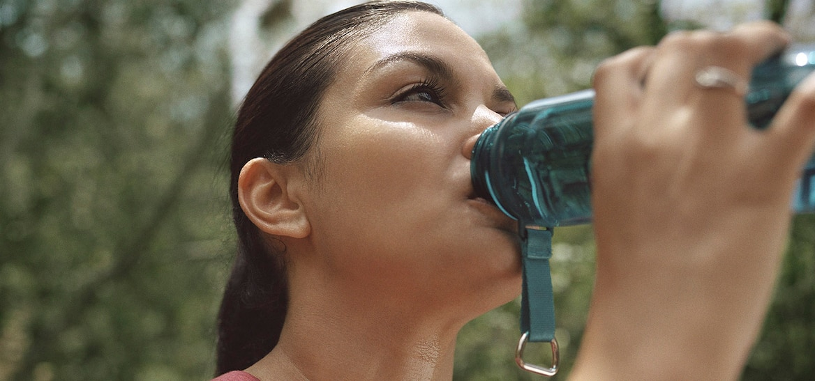 Woman drinking water during a hike