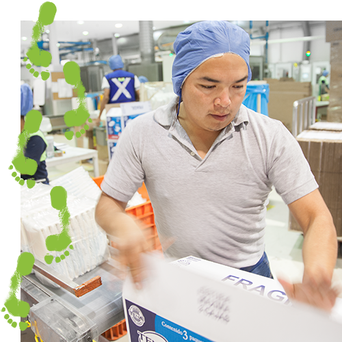 TENA factory worker closing a package