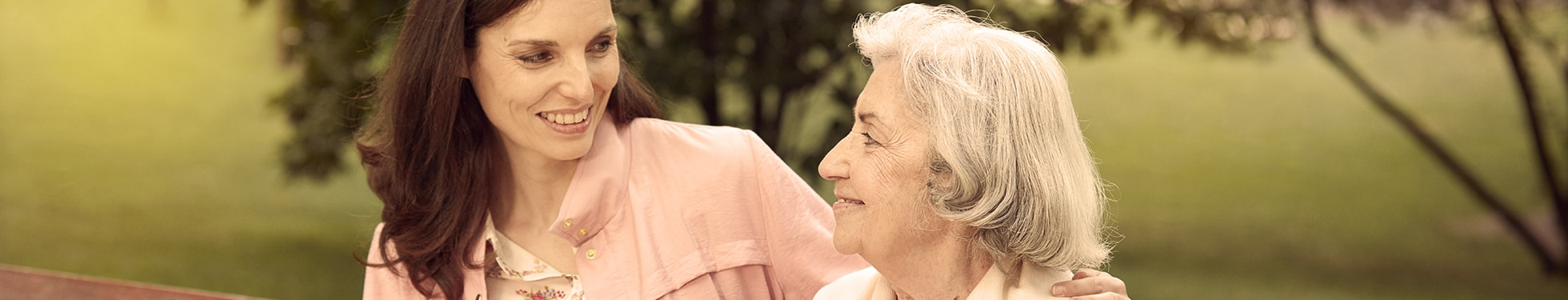 Older woman sitting with younger woman – useful tips for those new to caregiving