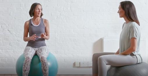 3 women sat on exercise balls