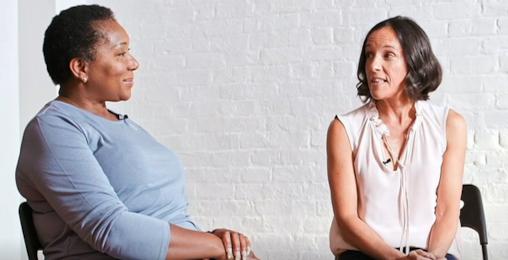 2 women sat talking