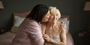 Elderly woman and her younger relative enjoy each other's company