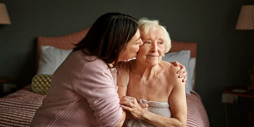 TENA-ProSkin-CGR-Lifestyle-image-for-web-Woman-hugged-by-carer-500x250.jpg