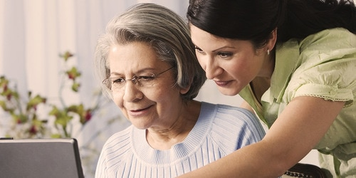 Elderly woman and young woman using the computer