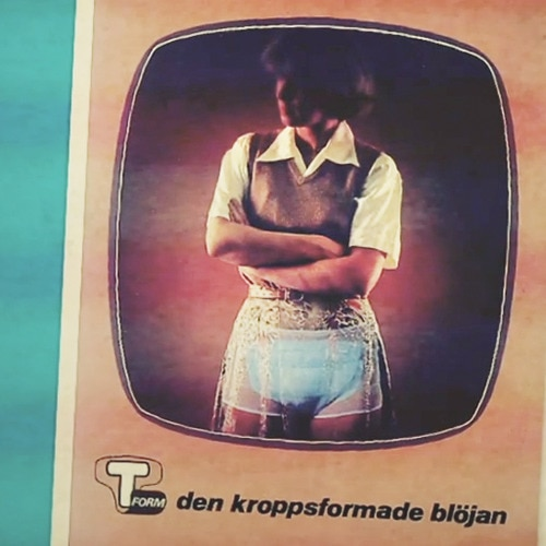 A print ad from the 1960s shows a model wearing disposable incontinence diapers.