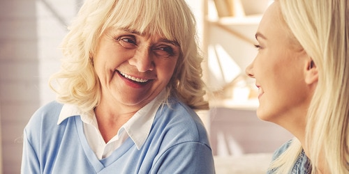 Older woman laughing with younger woman