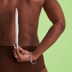 Woman holding a TENA Discreet Normal showing how thin it is