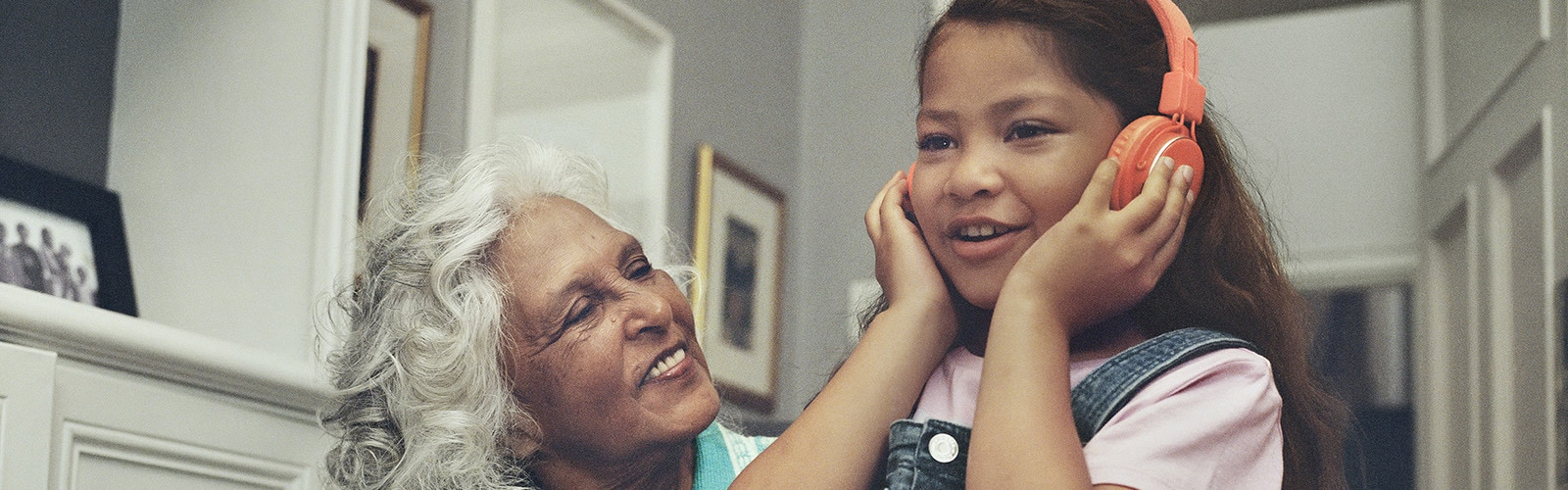 Elderly woman and young girl listening to music