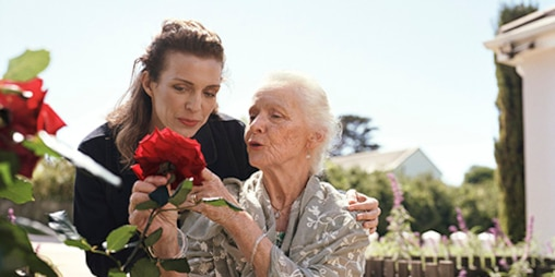 TENA-CGR-Lifestyle-image-for-web-older-woman-looking-at roses-500x250.jpg