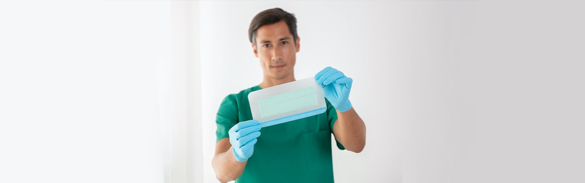 Sorbact technology-coated microbial binding post-op dressings