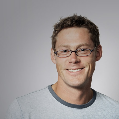 Man smiling wearing glasses