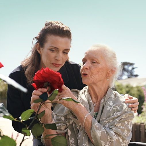 TENA-CGR-Lifestyle-older-woman-looking-at-roses-500x500.png
