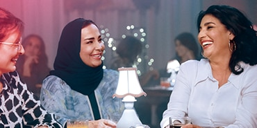 Three women laughing out loud