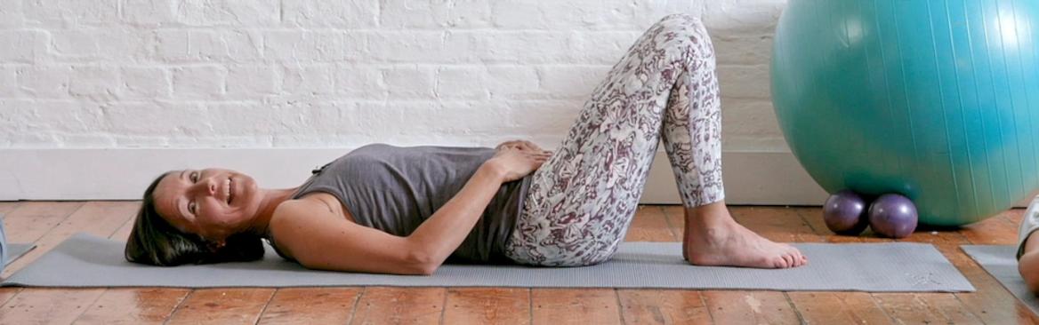women on yoga mat