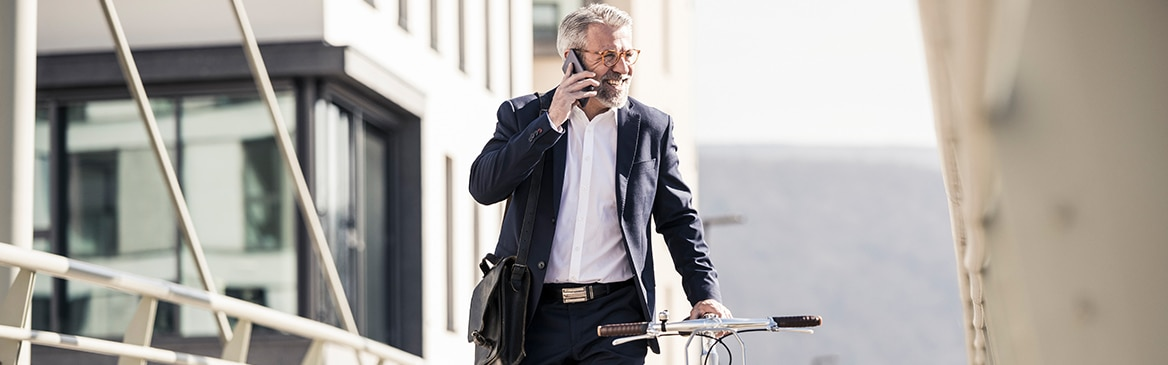 Old business man walking on the phone