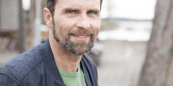 Man with beard smiling wearing