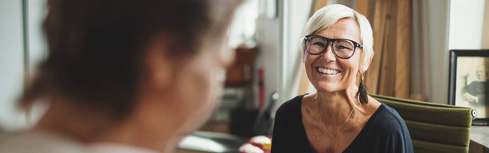 Mature woman wearing glasses smiling