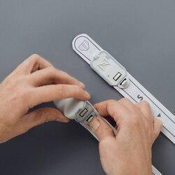 Como fixar o transmissor à fita de sensor