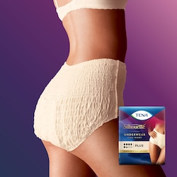 A woman from the side wearing a TENA Silhouette Creme high waist