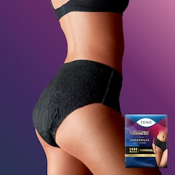 A woman from the side wearing a TENA Silhouette Black low waist normal