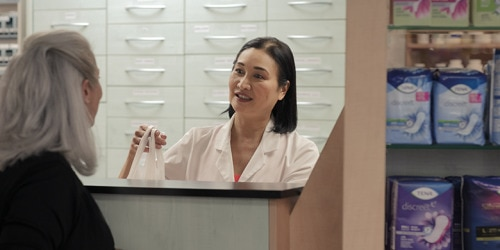 256147_TENA-Prof-Pharmacy-Female-pharmacist-with-female-customer-by-counter_780x390.png