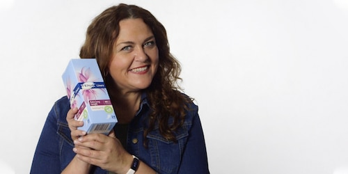 Chrissie Swan holding a box of TENA Liners Extra Long