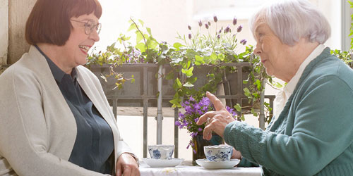 two-women-having-coffee-on-the-balcony_500x250px.jpg