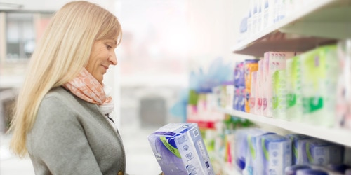 Woman shopping for incontinence products