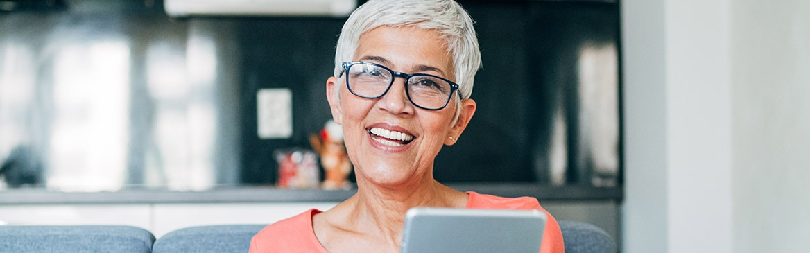 Lady smiling holding an ipad